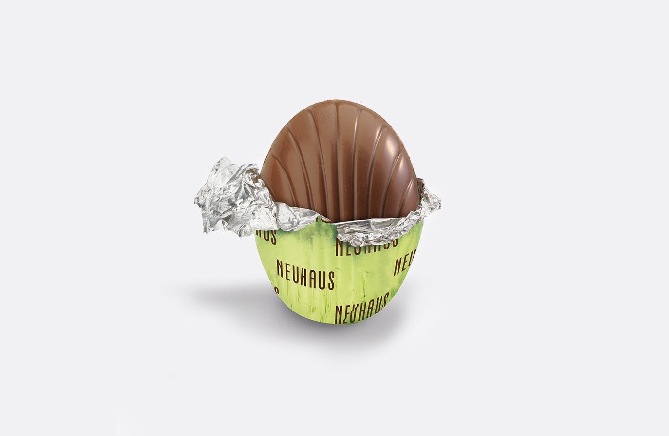 emballage aluminium pour oeufs au chocolat au lait de Neuhaus, collection printemps